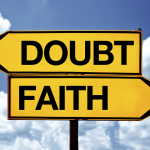 Doubt or faith, opposite signs. Two blank opposite signs against blue sky background.